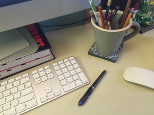 desktop with keyboard and pen